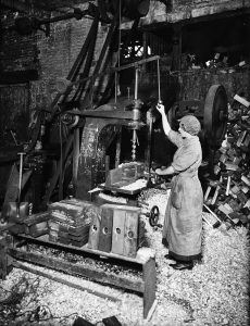 Woman Operating Boring Machine Boring Wooden Reels For Winding Barbed Wire